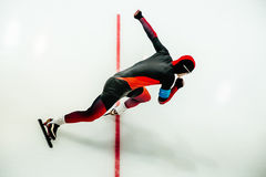 Male athlete speed skater start. In sprint race in competitions speed skating Royalty Free Stock Image
