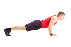 Male athlete in a sportswear doing push ups Stock Photo