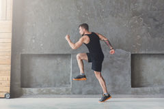 Male athlete sprinter running, exercising indoors Stock Photography