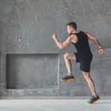 Male athlete sprinter running, exercising indoors Royalty Free Stock Image