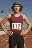 Male Athlete Standing On Racetrack Stock Photo