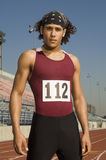 Male Athlete Standing On Racetrack stock image