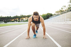 Male athlete on starting position Stock Photo
