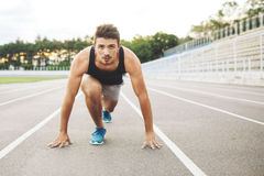 Male athlete on starting position Stock Image