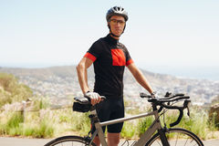 Male athlete taking a break after cycling training session Royalty Free Stock Image