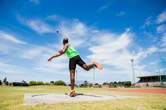 Male athlete throwing shot put ball Royalty Free Stock Photos