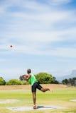 Male athlete throwing shot put ball Stock Photos