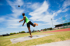 Male athlete throwing shot put ball Royalty Free Stock Images