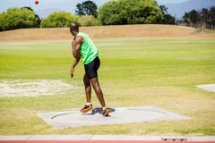 Male athlete throwing shot put ball Stock Photo
