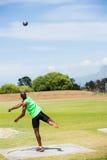 Male athlete throwing shot put ball. In stadium Stock Photo