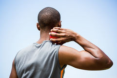 Male athlete about to throw shot put ball. Rear view of male athlete about to throw shot put ball in stadium royalty free stock photos