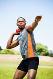 Male athlete about to throw shot put ball. In stadium royalty free stock photo