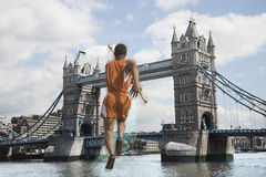 Male Athlete about to vault over Tower Bridge Royalty Free Stock Photos