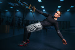 Male athlete on training, stretch workout Royalty Free Stock Photography