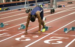 Male athlete on the turf. Men's 100 meter run, National Collegiate Athletic Association (NCAA) 2016 Indoor Track and Field event at Dix Stadium Field House, Kent Royalty Free Stock Photography