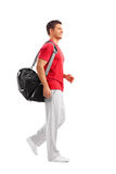Male athlete walking with a sports bag Royalty Free Stock Photos