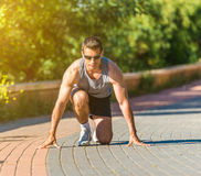 Male athlete warming up before jogging Royalty Free Stock Photo