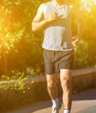 Male athlete warming up before jogging Royalty Free Stock Images