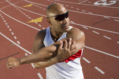 Male Athlete Warming Up Before Race Royalty Free Stock Photos