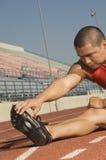 Male Athlete Warming Up In Stadium Stock Photos