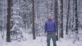 Male athlete warming up in the winter forest. Inspiration and motivation concept outdoors. Man trail runner running in winter forest. Inspiration and motivation stock video