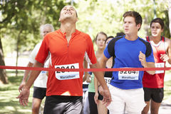 Male Athlete Winning Marathon Race Stock Photo