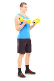 Male athlete working out with dumbbells isolated on white backgr Stock Photography