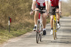 Male Athletes Riding Bicycles Royalty Free Stock Photography