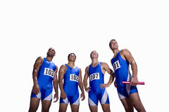 Male athletes in row, smiling, low angle view, cut out Stock Photography