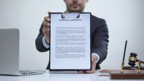 Male attorney holding marriage agreement, family law governs marital property. Stock footage stock video footage