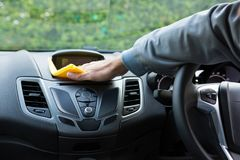 Auto service staff cleaning car interior. Male auto service staff cleaning car interior Stock Photos