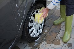 Auto service staff washing a car with sponge Royalty Free Stock Photo