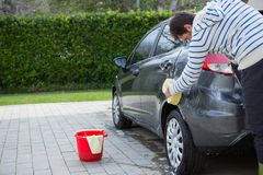 Auto service staff washing a car with sponge Royalty Free Stock Images