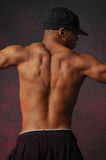 Male back with black hat. African american mixed race male portrait he's wearing a black trucker cap Stock Photo