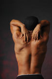 Male back with fingers. African american male back reaching over his shoulders with his fingers Royalty Free Stock Images