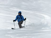 Male backcountry skier telemark skiing in the Alps in fresh powder Stock Photography
