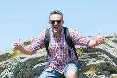 Male backpacker being happy showing thumbs up Stock Image