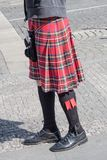 Male Bagpiper wearing Highland dress on the Street. Part of Male Bagpiper wearing the traditional Kilt stock images