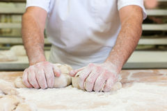 Male baker baking bread Stock Photo