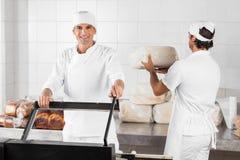 Male Baker Using Vacuum Seal Machine In Bakery Stock Image