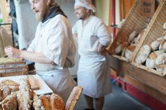 Male bakers stock photography