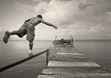 Male Balancing on One Foot Stock Photos