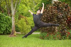 Male ballerina dancing in the park Royalty Free Stock Photo