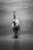 The male ballet dancer posing over gray background Royalty Free Stock Photography