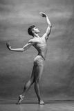 The male ballet dancer posing over gray background Stock Images