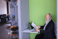 Male Banker or money agent in old age solves important work issu. Grandpa working on pension communicates with potential business partners and negotiates Stock Photography