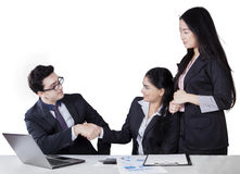 Male banker shaking hands with customer Stock Image