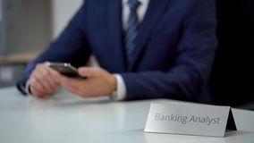 Male banking analyst checking email on smartphone, scrolling and zooming files. Stock photo royalty free stock image