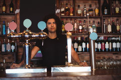 Male bar tender at bar counter Royalty Free Stock Photography