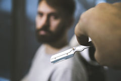 Male barber�s hand with a blade royalty free stock photo